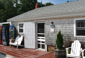 The Airport Laundromat, July 2011. It looks just like that now, except the storm door is up and usually shut.