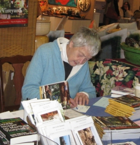Author Cynthia Riggs signs a book at an Artisans' Festival, fall 2011.