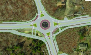 The proposed restaurant will be built SW of the roundabout. The access road will run through the parking lot.