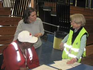 Drill coordinator Jim Thomas (left), the shelter manager, and a member of the Medical Reserve Corps hold a consultation.