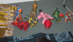 Miniature animals and baskets crafted in Rwanda, and samples of the beautiful cloth Grace brought back with her.
