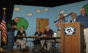 "It's hard to work up a rant about ""government"" when it looks a lot like us. Starting 2nd from left: executive secretary Jen Rand; selectmen Cindy Mitchell, Richard Knabel, and (standing) Skipper Manter; town counsel Ron Rappaport; and moderator Pat Gregory."