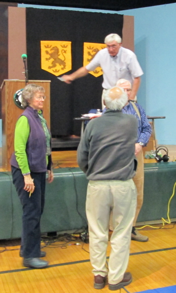 Moderator Pat gives instructions to the volunteer vote counters at last month's annual town meeting.
