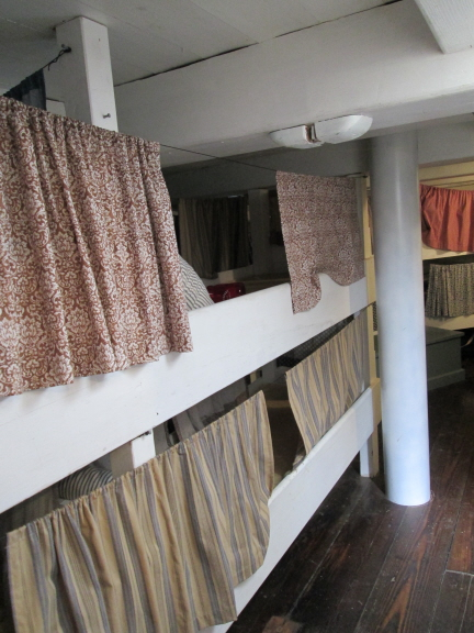 "The fo'c's'le (forecastle), where the crew slept. The Morgan is ""beamy,"" relatively wide, which means there was room for each crew member to have his own bunk. The bunks were relatively long -- up to six feet -- but the headroom wasn't much."