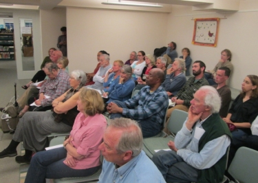 Housing 101 attendees in the downstairs program room of the Vineyard Haven public library.